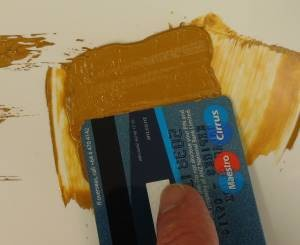 using a credit card to paint texture
