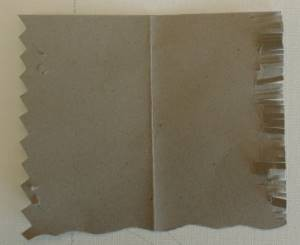 cut shapes into cardboard to create texture