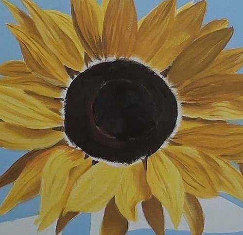 painting the center piece of the sunflower