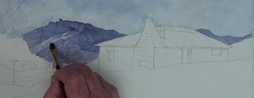 how-to-paint-a-cottage-in-a-valley-landscape-in-watercolor-distant-hills