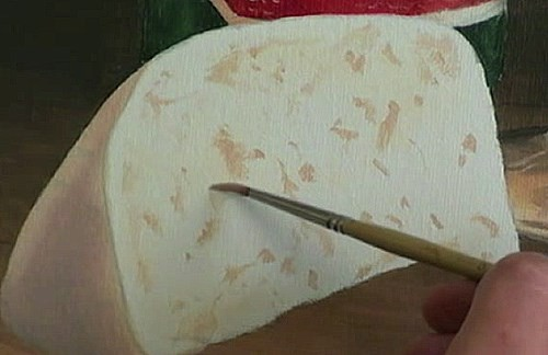 adding detail to the cheese