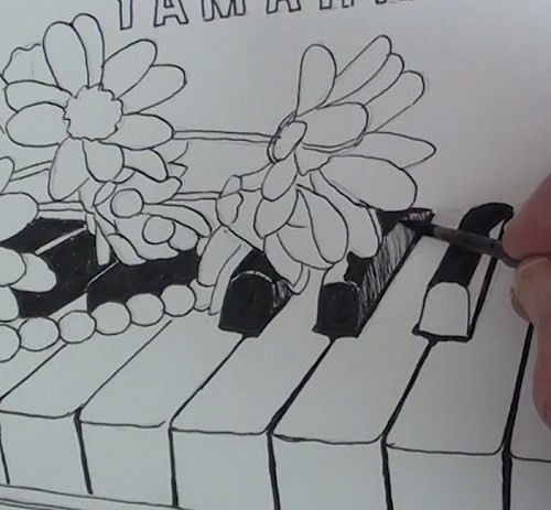 drawing-flowers-on-a-piano-in-pen-and-ink-black-keys