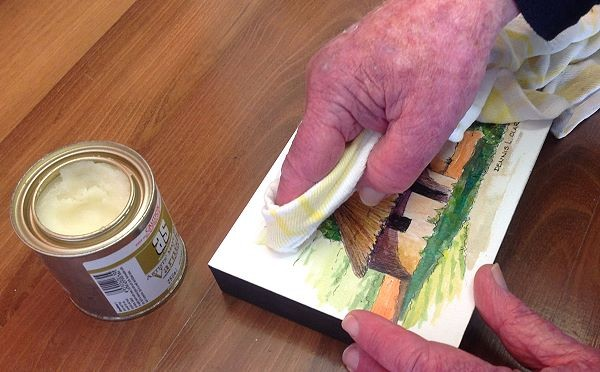 Wax Varnish being used to seal the watercolor painting