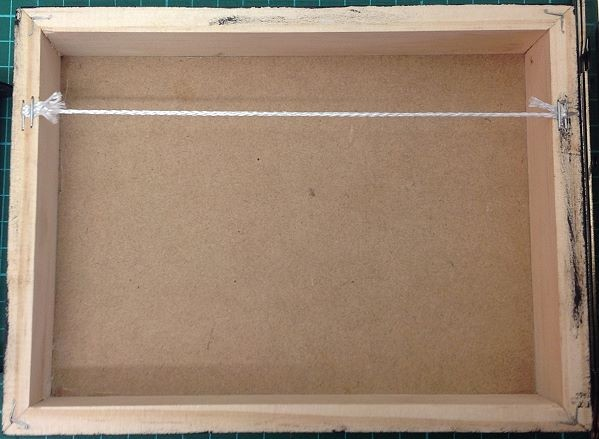 Back view of box frame with string attached